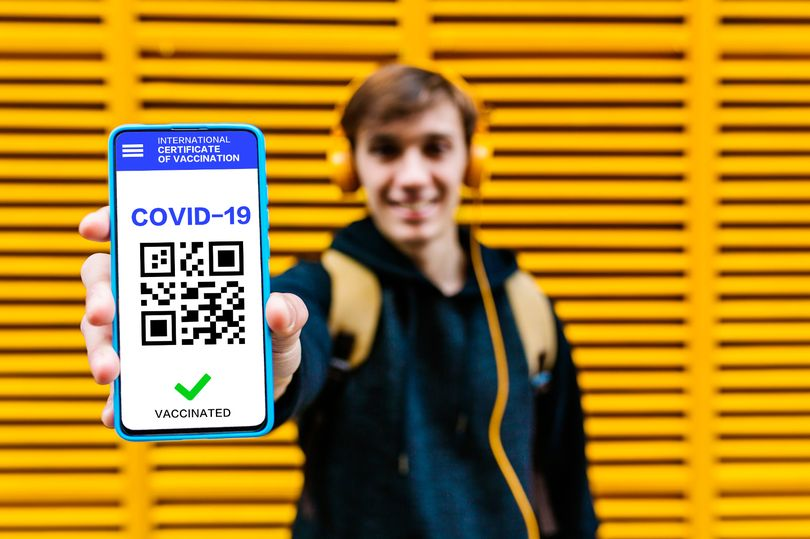 1_Man-showing-covid-19-vaccination-certificate-on-mobile-phone-screen